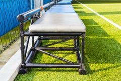 Benchs in indoor football field Stock Images