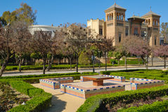 Benchs  with wiews to Mudejar Pavilion. Maria Luisa park, with views of Mudejar Pavillion built for the Ibero-American Exposition of 1929 at Seville, Spain Royalty Free Stock Photography