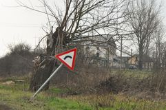 Bend ahead to right. Danger road signs. Deteriorated traffic signs on a curve royalty free stock photo