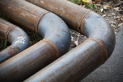 Bend of industrial steel pipeline Royalty Free Stock Photo