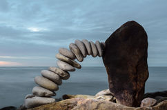 Bend of pebbles. At of the stone on the coast Royalty Free Stock Photo