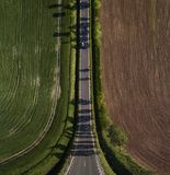 Bend perspective road. Abstract landscape, bend perspective road through the field with copy space Royalty Free Stock Images