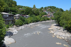 Bend of Rioni River in Kutaisi, Georgia. Bend of Rioni River in Kutaisi with houses on the shore, Georgia Stock Photo