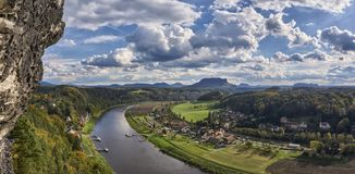 Bend in the river Elbe, Saxon Switzerland Germany. Looking down on the rivier Elbe where the waterway takes a sharp turn. Beautiful conditions with white cumulus stock photography