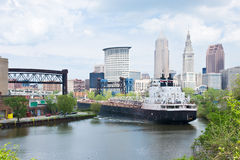 Bend In The River. A Great Lakes bulk carrier freighter negotiates a very tight bend in the Cuyahoga River. Downtown Cleveland, Ohio is in the background royalty free stock photography