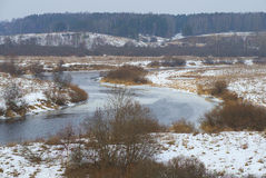 The bend in the river Sorot cloudy February day. Pushkin mountains Royalty Free Stock Photos