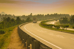 A Bend in the Road. A bend on the NH47 captured on a cloudy, moody evening Royalty Free Stock Photo