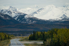 Bend in the Road Alaska Mountain Highway Transportation Royalty Free Stock Photos