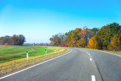 Bend in the road a picturesque location field Stock Photo