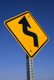 Bend in road sign. The Bend in road ahead sign with blue sky background royalty free stock photos