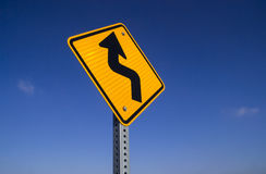 Bend in road sign. The Bend in road ahead sign with blue sky background royalty free stock photo