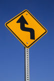 Bend in road sign. The Bend in road ahead sign with blue sky background royalty free stock image