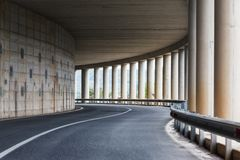 Bend of the road in a tunnel with columns Stock Images