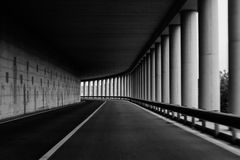 Bend of the road in a tunnel with columns Royalty Free Stock Image