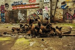 Bend and rusted metal in abandoned industry hall royalty free stock images