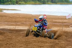 On the bend. SERPUKHOV, RUSSIA - OCTOBER 7, 2017: Potaruev Aleksandr 757,  Class ATV, in the 4 stage  MX series, the Red Wings Cup 2017 super country-cross, Moto Stock Images