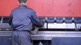 Bend steel create a curved metal piece. worker stock video footage