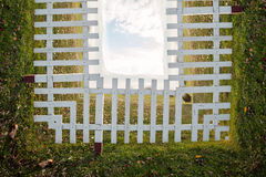 Bend wooden fence on field Royalty Free Stock Images