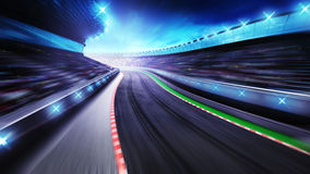Bended asphalt racetrack with stands around Stock Photos