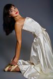 Bended bride. Pretty young woman dressed wedding gown and high heels Royalty Free Stock Photo
