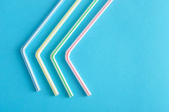 Bended drinking straws. On a blue background royalty free stock image