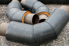 Bended Pipes for Water Pipeline with Isolation in Stack on Ground Royalty Free Stock Image