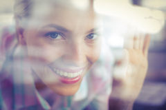 Bended pretty woman looking through the glass Royalty Free Stock Photos