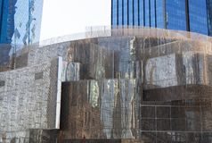 Bended sheets of welded wire mesh for modern building frame with skyscrapers on the background, bottom view, vertical. Curved sheets of welded wire mesh for stock image