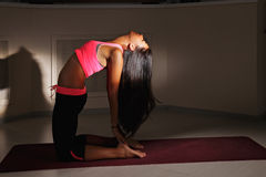 Bending back yoga in darkness Royalty Free Stock Photography