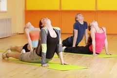 Bending backs in group aerobics. Group bending backs at aerobics training in gym selective focus Stock Photo