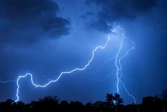 Bending Blue Bolt. Cloud to ground lightning strikes over Albuquerque, New Mexico. July, 2011 Stock Image