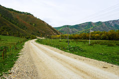 Bending of a dirt road in the mountains Royalty Free Stock Photo