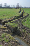 Bending ditch in winter country Stock Images