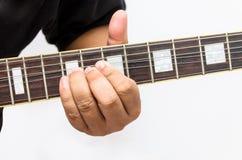 Bending guitar string Stock Images