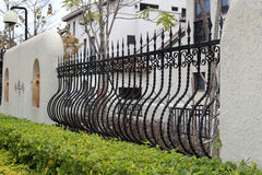 Bending iron fence Stock Images