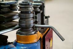 Bending machine. Automatic bending machine for metal tubes Stock Photography