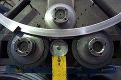 Bending machine. Close up bending machine work in the factory Royalty Free Stock Photos