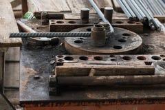 Bending machine rebar. Specialist using steel bending machine rebar for building equipment Stock Images