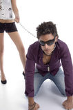 Bending man with chain and sunglasses Royalty Free Stock Image