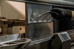 Bending of metal on the machine. Royalty Free Stock Image