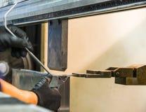 Bending of metal on the machine. Stock Image