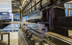Bending of metal on the machine. Stock Photography