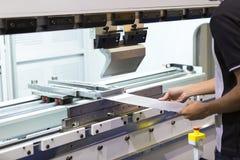 Bending metal sheet by sheet bending machine Stock Photos