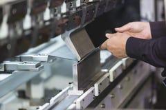 Bending metal sheet by sheet bending machine Stock Images