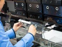 Bending metal sheet by sheet bending machine. Operator bending metal sheet by sheet bending machine Royalty Free Stock Photo