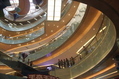 Bending of the modern shopping mall with Luxurious interior decoration in SHENZHEN. The modern shopping mall Luxurious interior decoration ,it shape is bending Stock Photos