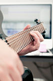 Bending Notes On The Guitar. Close up of a man's hand playing guitar Royalty Free Stock Images