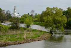 Bending river and the distant Christian church Stock Photo