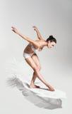 Bending sepia woman on white feather Stock Image