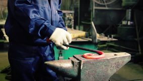 Bending steel in a smithery stock video footage